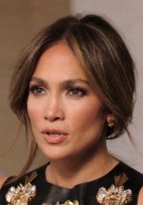 Jennifer Lopez wearing the Rose Gold Panther and Paw earrings