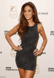 Nicole Scherzinger wears the 2 Finger Chain Ring in Yellow Gold and the Panther and Paw ring to the Children in Need Gala
