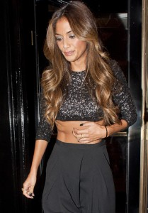 Nicole Scherzinger wears the 2 Finger Chain Ring in Yellow Gold leaving the X Factor studios